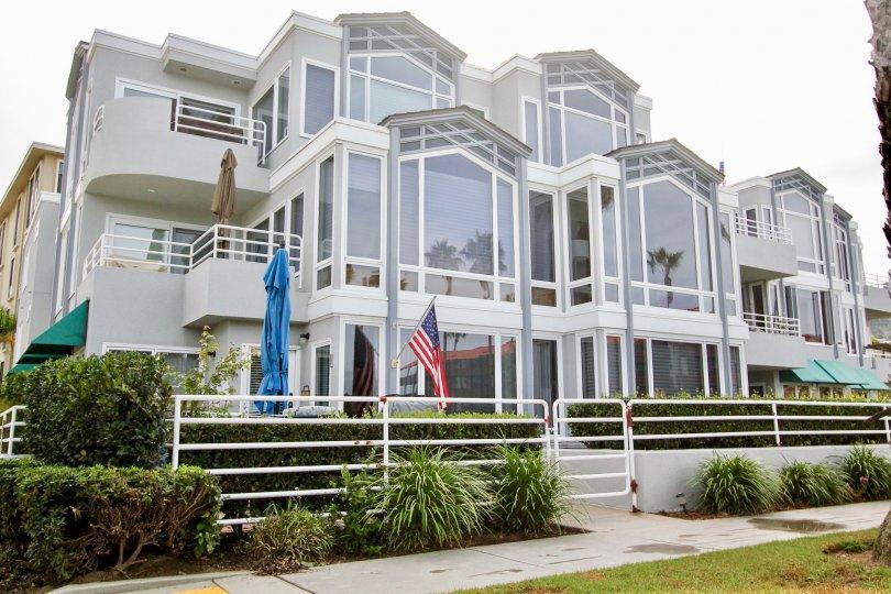 LJ Windigo Three-Story Gray Building with Large Windows La Jolla California