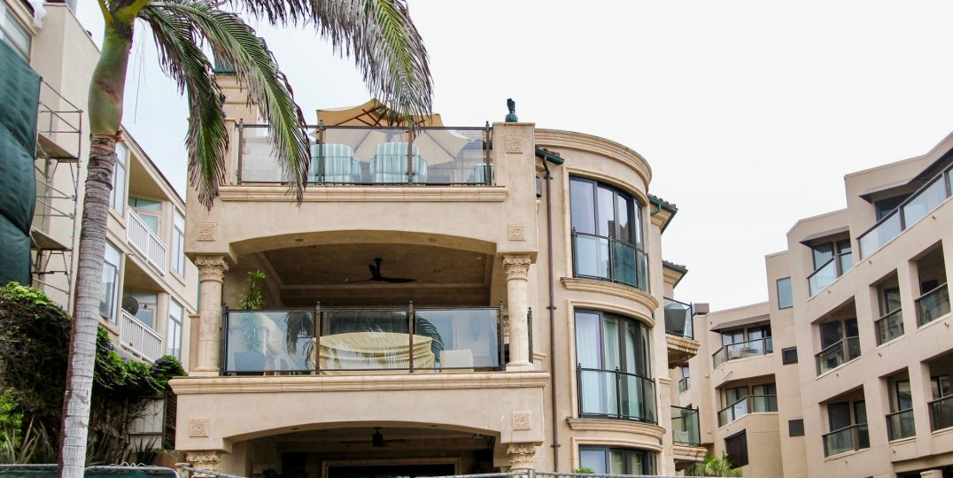 Three story housing with glass walls & windows inside Miramare in La Jolla California