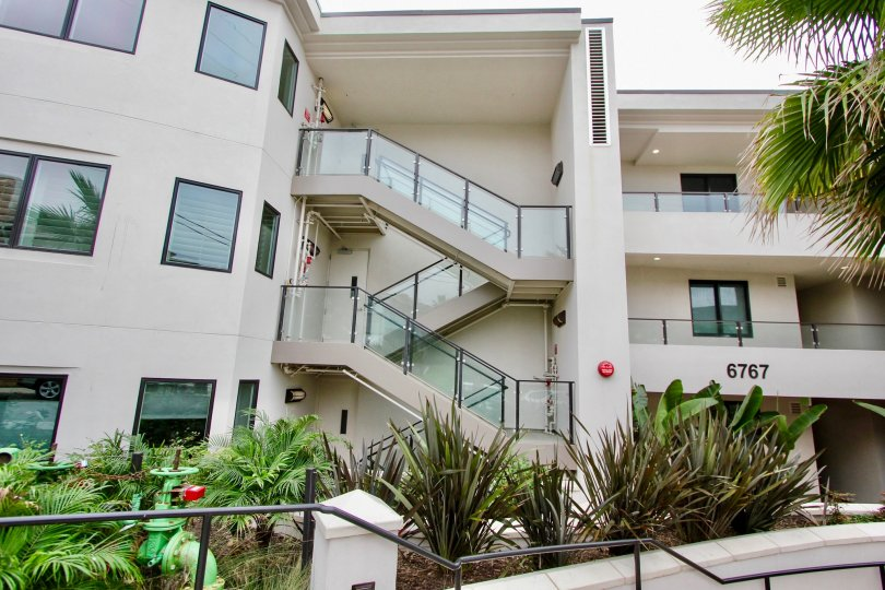 Three story residence with glass stairway inside One Neptune at La Jolla CA