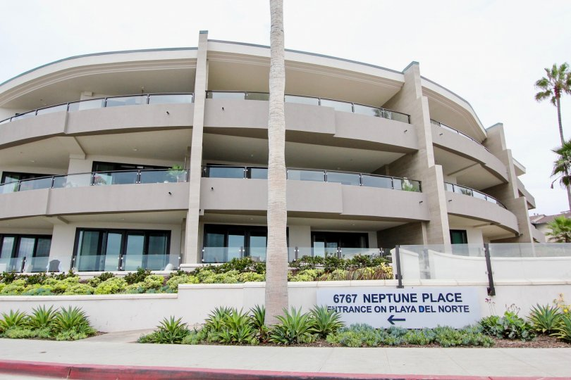 Round four story building at One Neptune in La Jolla CA