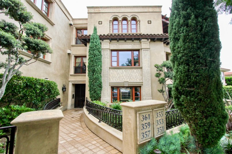 Three story condominium units with tiled walkway inside Prospect Point Villas in La Jolla CA