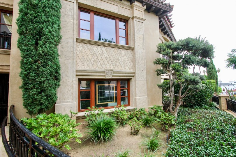 Beautiful landscaping presenting the windows of Prospect Point Villas in La Jolla, California