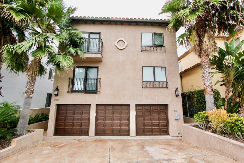 Three story pink condos with attached garages inside Prospect Seaview Villas in La Jolla CA
