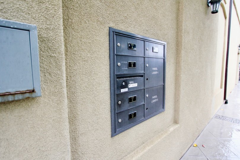 Mail boxes on a brown wall inside Prospect Village in La Jolla CA