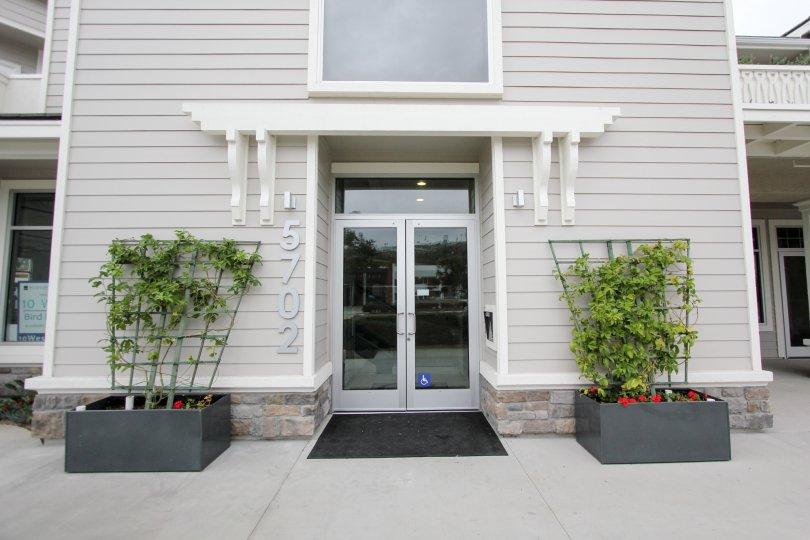 Gray entrance into a residential building inside Rosemont Condos in La Jolla CA