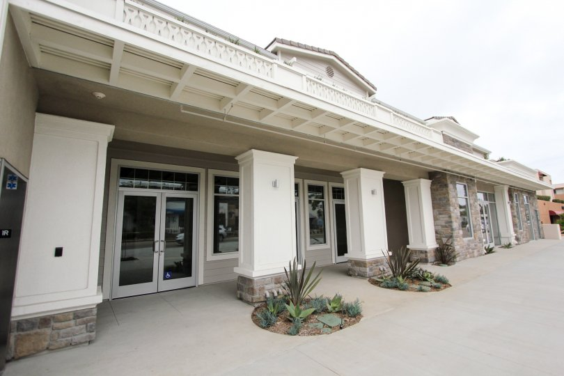 Many glass doors on the front of a building in Rosemont Condos at La Jolla CA