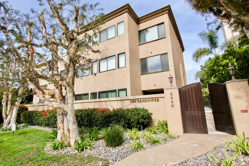 Three story housing behind wall inside Sandpiper in La Jolla CA