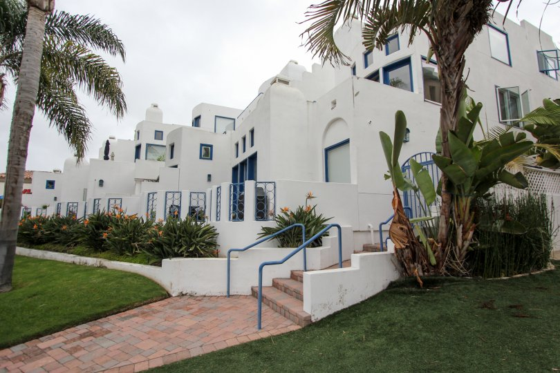 Pink brick stairway leading to white residences inside Santorini West in la JOlla CA