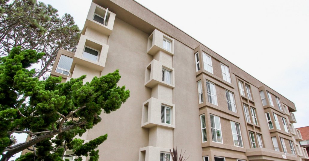 Brown building with lots of windows at Shorepoint in La Jolla CA