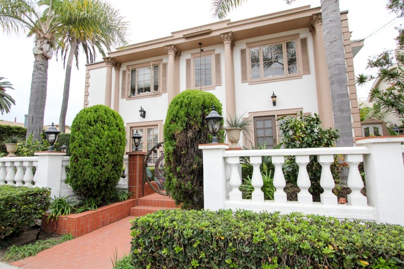 Two story home with brown roman style pillars in Village Chateau at La Jolla CA