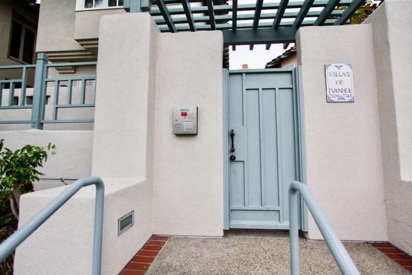 blue door in front of a blue railing inside villas of ivanhoe in la jolla ca