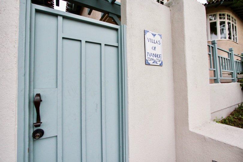 Blue door with a black handle at Villas of Ivanhoe in La Jolla CA