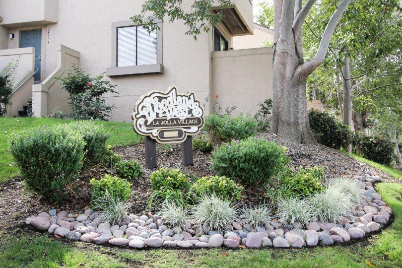 Sign in garden area for Woodlands West I community in La Jolla
