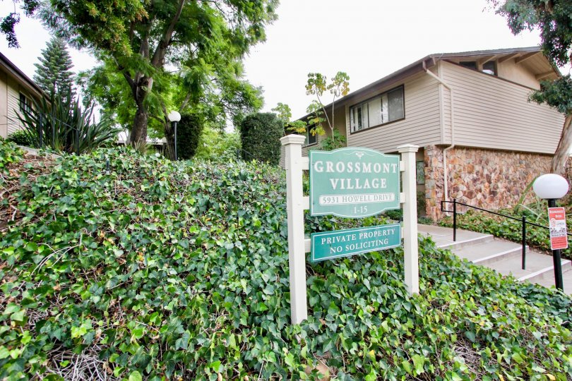 Excellent approach and green leaves with lamp and board in front of a villa in Grossmont village of La Mesa