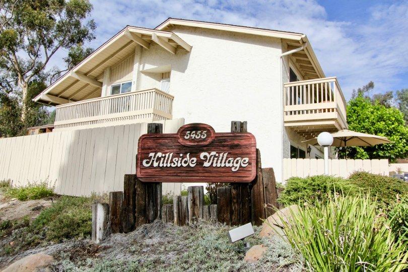 The Board in Hillside Village marked Hillside Village with 5455 number between bushes