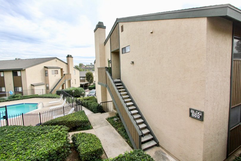 In BLDG 800 apartment with swimming pool with chairs and bushes in Parkway Manor
