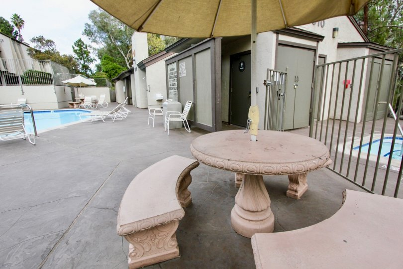 the Parkway Pointe with tables and chairs near to the swimming pool