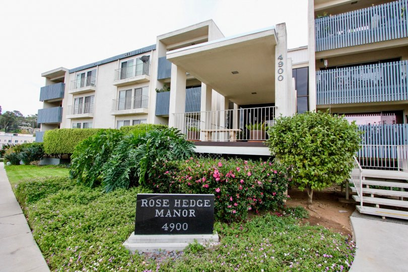 A sunny day in the area of Rosehedge Manor, outside, condos, flowers, bushes, balcony, gate