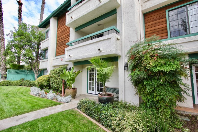 Beautiful Villa with a balcony and lawn with trees in front in Shasta Greens of La Mesa