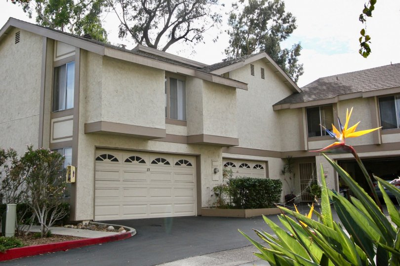 A two story condominium complex with a green hedge at La Mesa CA in Strawberry HIlls