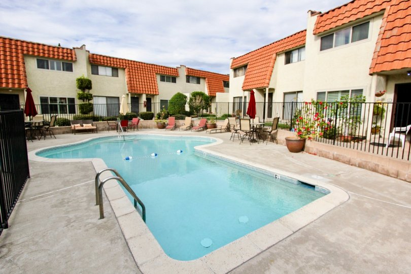 A mushroom shaped pool surrounded by buildings at Tangerine Terrace at La Mesa CA