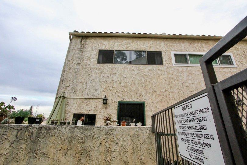 Side gate view of Villa De Fanta community, Le Mesa, CA