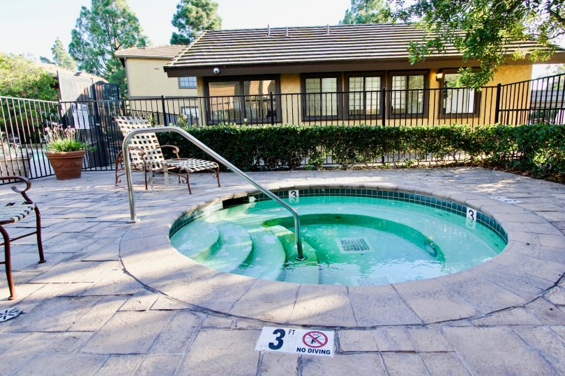 A sunny day, in front of decorative pool with chairs in Arbor Ridge community, Mira Mesa, CA