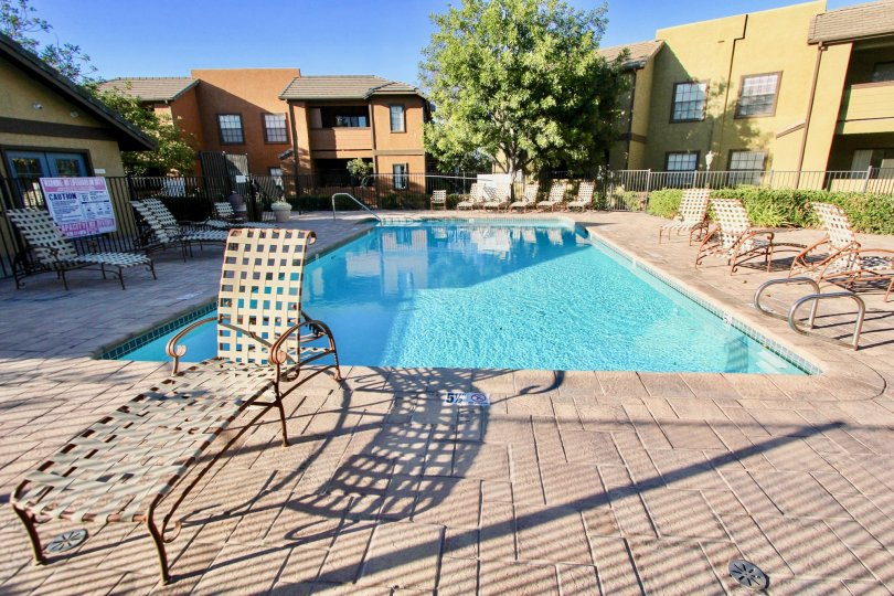 Swimming pool near residential buildings at Arbor Ridge in Mira Mesa California
