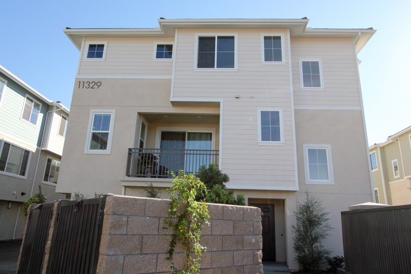 Three story town-home with gated dumpsters at Aura in Mira Mesa California