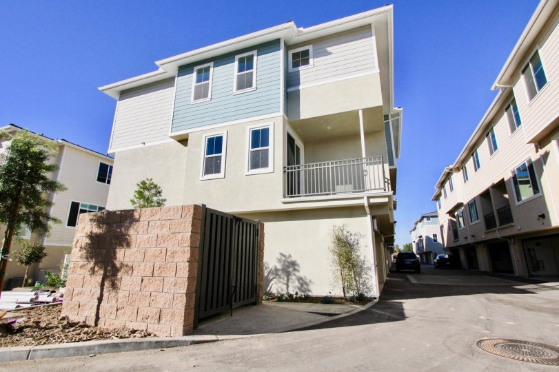 Three story residential units with enclosed dumpster at Aura in Mira Mesa California