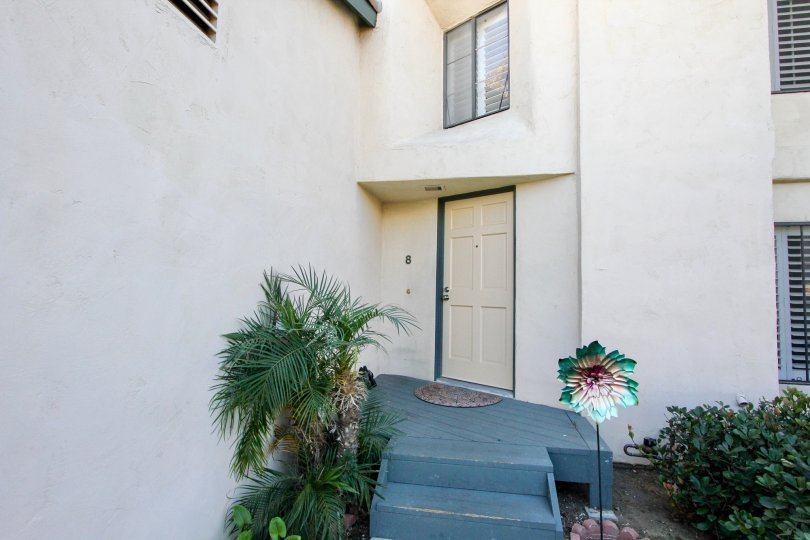 The Front side of the door in a house shows good decoration in Black Mountain Villas of Mira Mesa City