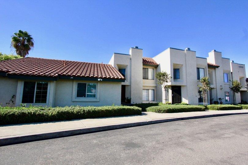 Driveway near two story residential buildings at Black Mountain Villas in Mira Mesa California