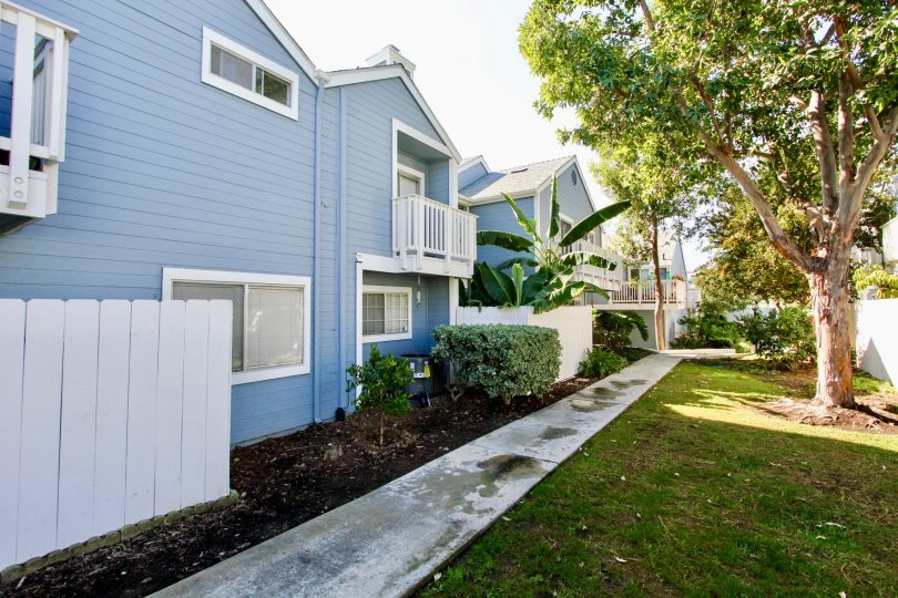 Sidewalk near two story residential buildings at Canyon Colony in Mira Mesa California