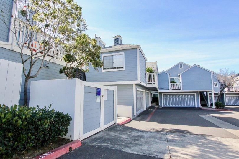 Residential buildings with attached garages at Canyon Colony in Mira Mesa California