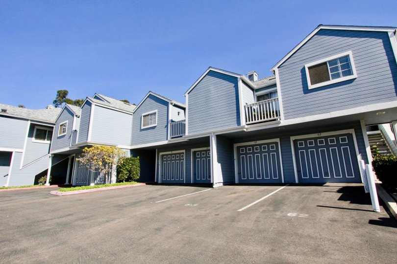 A sunny day in the area of Canyon Colony, outside, parking lot, garages, balconies, condos, stairs