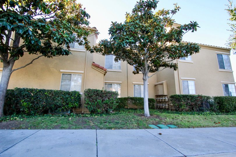 Two story residential building near a sidewalk at Canyon Park Villas in Mira Mesa California