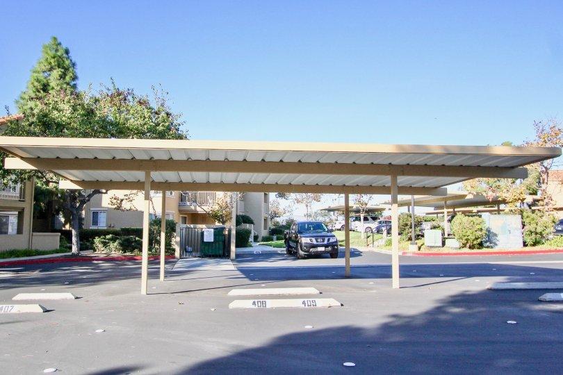 Covered park near residential units at Canyon Park Villas in Mir Mesa California