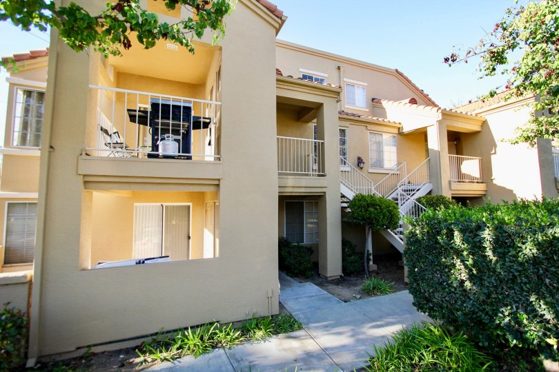 Canyon Park Villas , Mira Mesa ,: California,cream building, plants