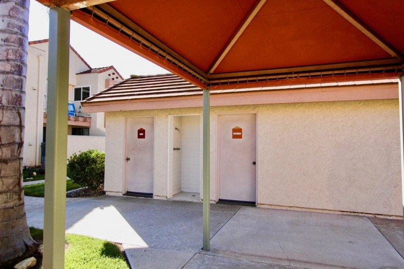 Restrooms under a canopy at Casa New Salem in Mira Mesa California