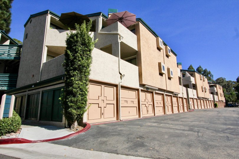 Condominiums with attached garages near a driveway at Creekside in Mira Mesa California