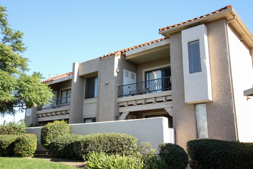 Two story residential units with cement wall at Flair in Mira Mesa California