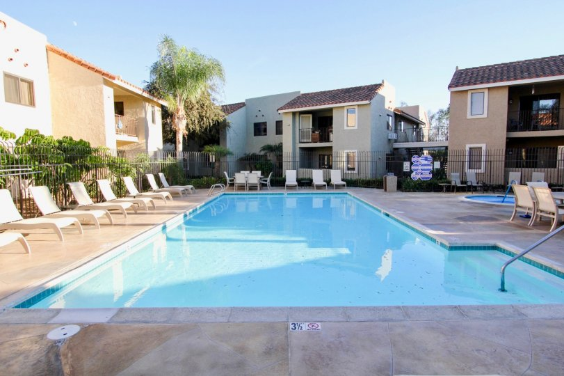 Front pool view with chairs in Jade Coast Community in Mira Mesa, CA