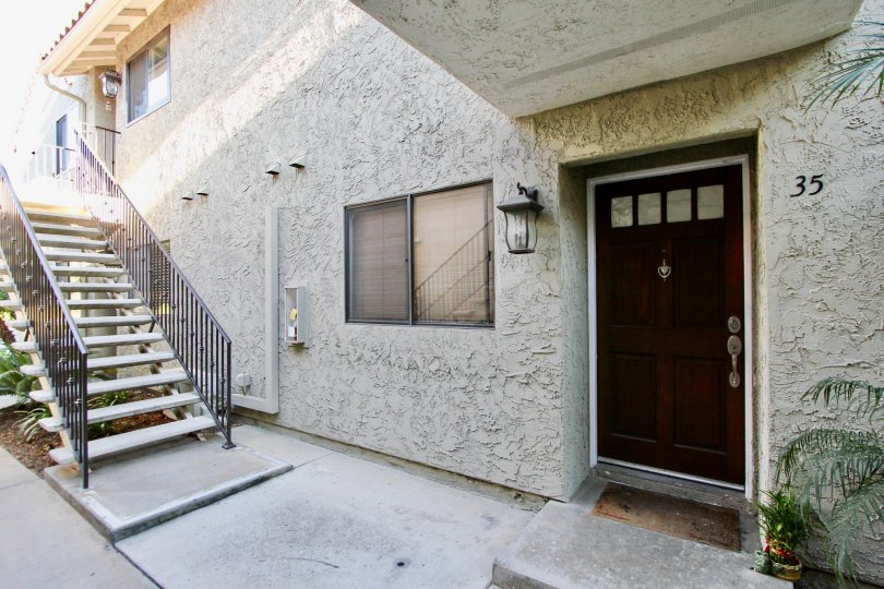 Entrance of a residence near a stairway at Jade Cost in Mira Mesa California
