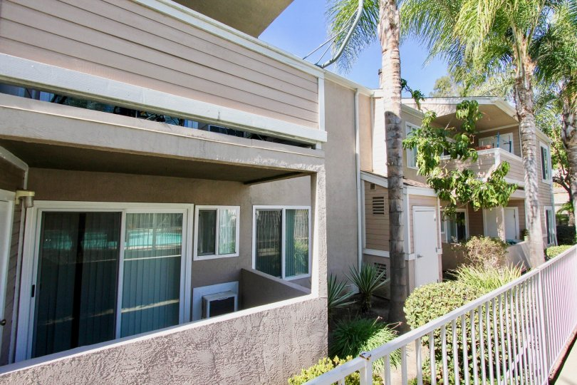 A SUNNY DAY IN THE MIRABELLA POINT WITH A HOUSE THAT IS IN THE GATED COMMUNITY