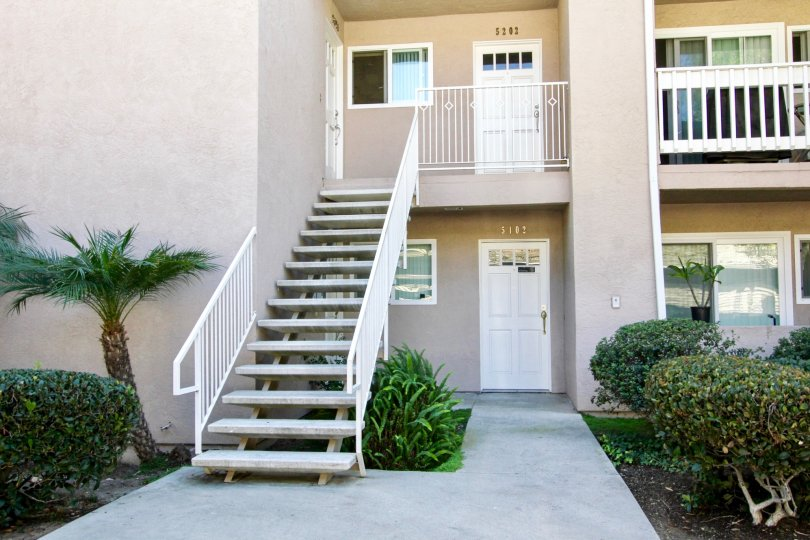 A sunny day in the area of Mirabella Point, stairs, balcony, outside, street, palm tree, door