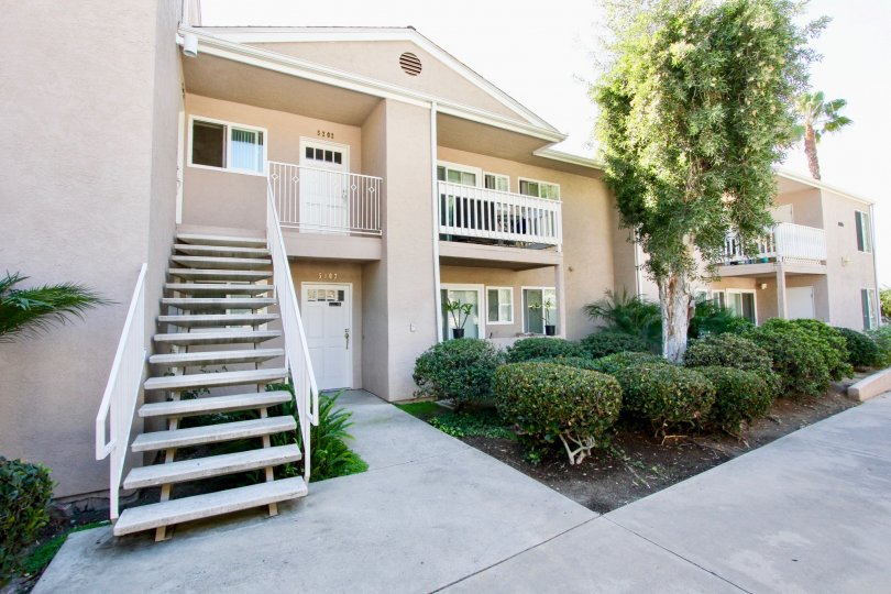 Two story residential building with attached stairway at Mirabella Point in Mira Mesa California