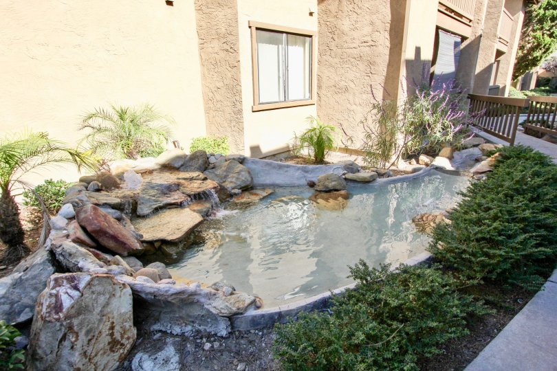Lovely water feature landscaping welcomes you home to Quail Creek.