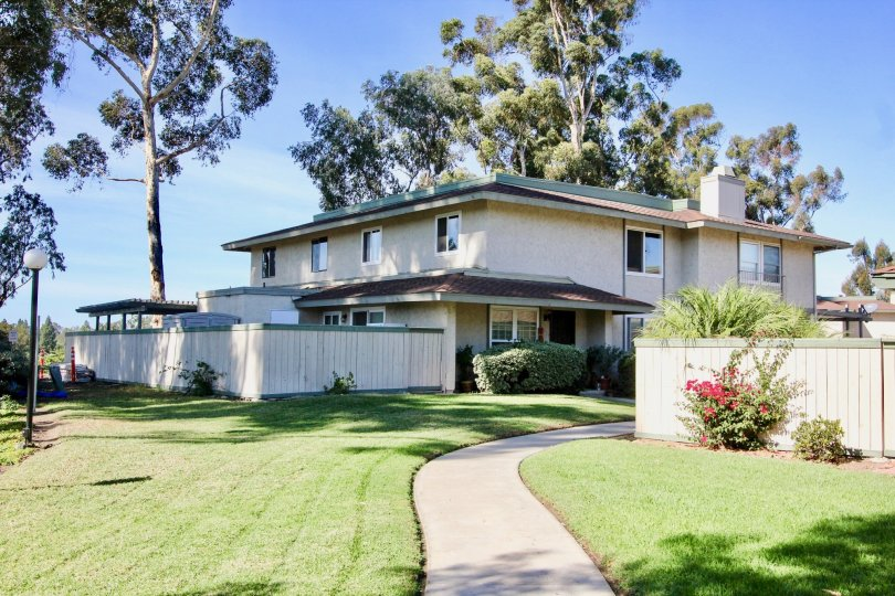 Two story housing units with large patio and green yard at Quest in Mira Mesa California