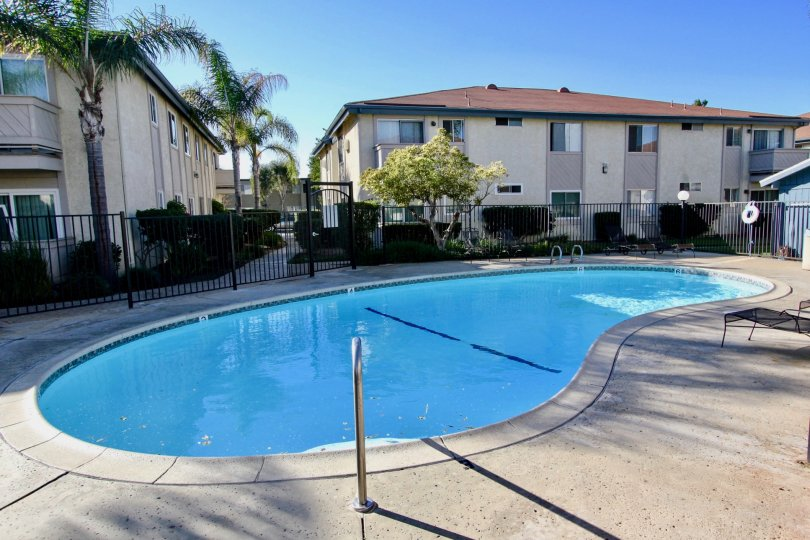 A small gated pool nearby units of the Villa Mar community in Mira Mesa, California.