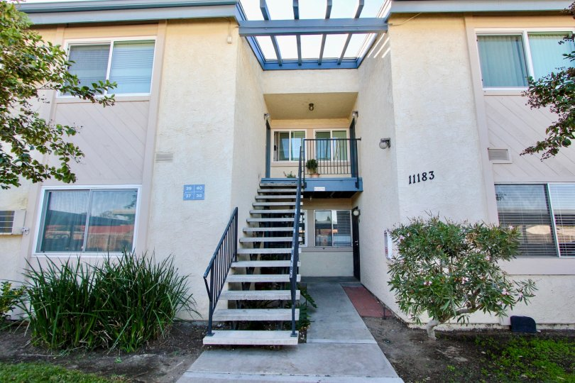 Two story residential building with attached stairway at Villa Mar in Mira Mesa California
